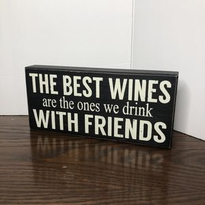 The best Wines are the ones we drink sign